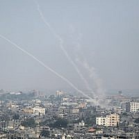 A picture taken on July 14, 2018 shows Palestinian rockets being fired from Gaza towards Israel (AFP/Bashar Taleb)