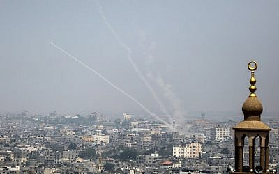 This picture taken on July 14, 2018, shows Palestinian rockets being fired from Gaza toward Israel. (AFP/Bashar Taleb)