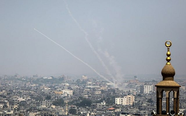 A picture taken on July 14, 2018, shows Palestinian rockets being fired from Gaza toward Israel (AFP/Bashar Taleb)