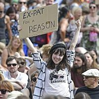 A protester holds up a placard as she takes part in the Scotland United Against Trump demonstration through the streets of Edinburgh, Scotland on July 14, 2018, on the third day of US President Donald Trump's four-day UK visit. (AFP/NEIL HANNA)
