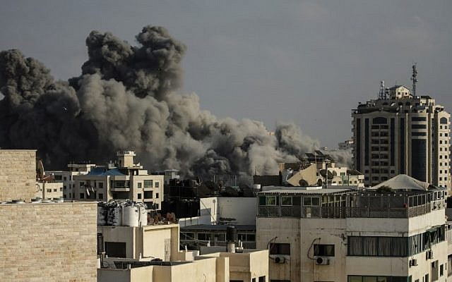 Smoke rises above buildings during an Israeli air strike on Gaza City on July 14, 2018. (AFP PHOTO / MAHMUD HAMS)