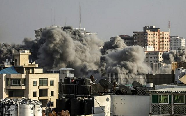 A picture taken on July 14, 2018 shows smoke plumes rising following an Israeli air strike in Gaza City. (AFP / MAHMUD HAMS)