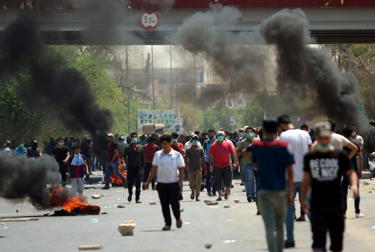 Iraq police fire in air as protesters storm Basra govt. building