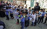 Palestinian children line up before the early start of classes at a school in the Bedouin village of Khan al-Ahmar in the West Bank on July 16, 2018. (ABBAS MOMANI/AFP)