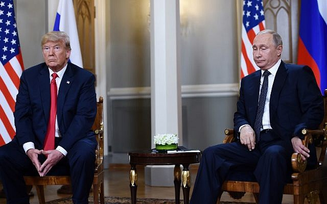 Russian President Vladimir Putin (R) and US President Donald Trump attend a meeting in Helsinki, on July 16, 2018. (Brendan SMIALOWSKI/AFP)