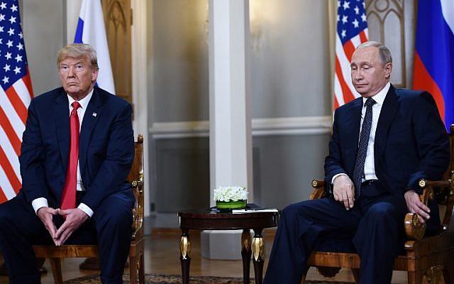Russian President Vladimir Putin (R) and US President Donald Trump attend a meeting in Helsinki, on July 16, 2018. (Brendan SMIALOWSKI/AFP)