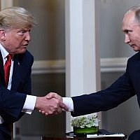 Russian President Vladimir Putin, right, and US President Donald Trump shake hands before a meeting in Helsinki, on July 16, 2018. (AFP Photo/Brendan Smialowski)