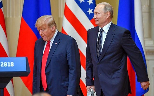 US President Donald Trump (L) and Russia's President Vladimir Putin arrive to attend a joint press conference after a meeting at the Presidential Palace in Helsinki, on July 16, 2018. (AFP PHOTO / Yuri KADOBNOV)