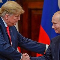 US President Donald Trump (L) and Russia's President Vladimir Putin shake hands before attending a joint press conference after a meeting at the Presidential Palace in Helsinki, on July 16, 2018. (AFP PHOTO/ Yuri KADOBNOV)