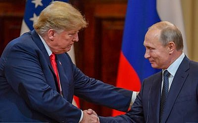 US President Donald Trump (L) and Russia's President Vladimir Putin shake hands before attending a joint press conference after a meeting at the Presidential Palace in Helsinki, on July 16, 2018. (AFP Photo/Yuri Kadobnov)