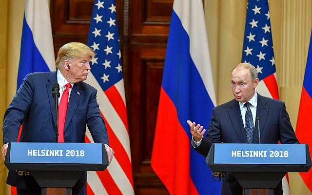 US President Donald Trump (L) listens as Russia's President Vladimir Putin speaks during a joint press conference after a meeting at the Presidential Palace in Helsinki, on July 16, 2018. (AFP/Yuri KADOBNOV)