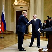 US President Donald Trump (L) and Russia's President Vladimir Putin shake hands after a press conference at Finland's Presidential Palace July 16, 2018 in Helsinki, Finland. (AFP / Brendan Smialowski)