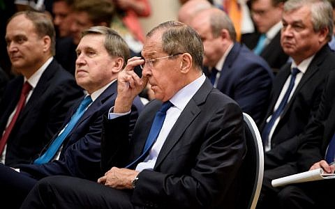 Russia's Foreign Minister Sergey Lavrov and others listen during a press conference by Russia's President and US President at Finland's Presidential Palace July 16, 2018 in Helsinki, Finland. (AFP/Brendan Smialowski)