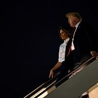 US President Donald Trump and First Lady Melania Trump arrive at Andrews Air Force Base in Maryland on July 16, 2018. (AFP Photo/Brendan Smialowski)