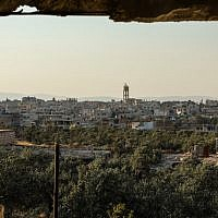 A view of the pro-Syrian government village of Fu'ah in the northwestern province of Idlib, July 17, 2018. (OMAR HAJ KADOUR/AFP)