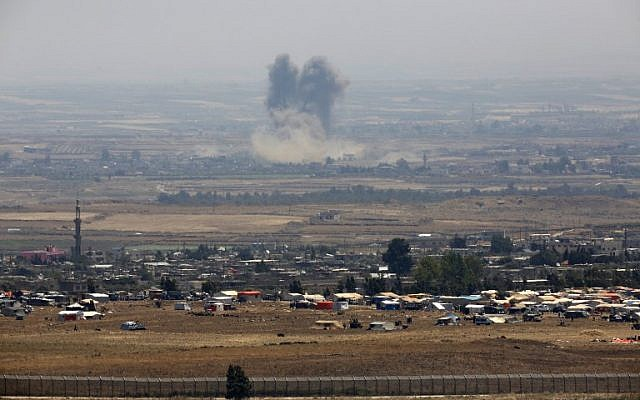 Israel russia said to work on return to 1974 deal for syrian border a picture taken from the israeli golan heights shows smoke rising above buildings during unidentified air stopboris Images
