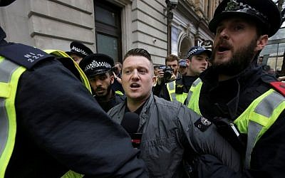 In this file photo taken on April 01, 2017 Stephen Christopher Yaxley-Lennon, AKA Tommy Robinson, former leader of the right-wing EDL (English Defence League) is escorted away by police from a Britain First march and an English Defence League march in central London (AFP PHOTO / Daniel LEAL-OLIVAS)