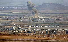 A picture taken on July 19, 2018 from the Golan Heights shows smoke rising in an area where Russian-backed government forces in Syria have been carrying air strikes near the village of al-Rafid in the southern Syrian province of Quneitra. (AFP/ JALAA MAREY)