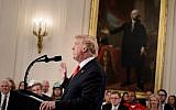 US President Donald Trump addresses the Pledge to America's Workers event at the White House in Washington, DC, beneath a portrait of the first US president George Washington.  (AFP/ Brendan Smialowski)