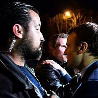 A picture taken on February 28, 2017 shows then French presidential election candidate for the En Marche! movement Emmanuel Macron (R) and Head of Security Alexandre Benalla (L) arriving for a campaign meeting in Angers, western France. (AFP/Jean-Francois Monier)
