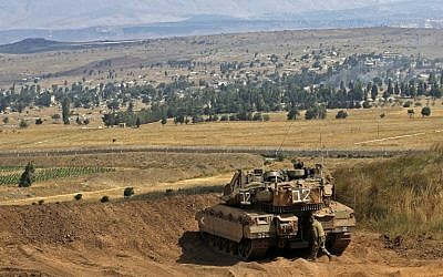 A picture taken on July 20, 2018, in the Golan Heights shows an Israeli Merkava tank taking position on the border between Israel and Syria. (AFP Photo/Jalaa Marey)