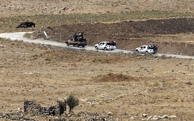 A picture taken on July 20, 2018, from the Israeli Golan Heights shows civilians leaving the Syrian village of Qahtaniyah in the southwestern Quneitra province. (AFP Photo/Jalaa Marey)
