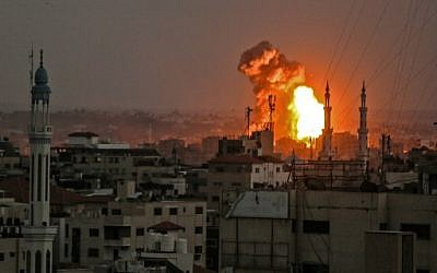A picture taken on July 20, 2018 shows a fireball exploding in Gaza City during Israeli bombardment. Israeli aircraft and tanks hit targets across the Gaza Strip on July 20 after shots were fired at troops on the border, the army said, with Hamas reporting several members of its military wing killed in the latest flare-up in months of tensions. ( AFP PHOTO / BASHAR TALEB)