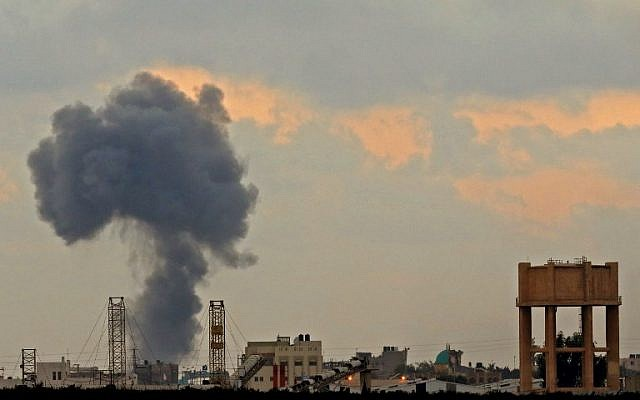 A picture taken on July 20, 2018, from across the border with the Gaza strip near the southern Israeli Kibbutz of Nahal Oz, shows a smoke plume rising from an explosion during Israeli bombardment in Gaza City. (AFP PHOTO / JACK GUEZ)