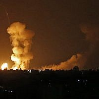 A picture taken on July 20, 2018 shows explosions from Israeli bombardment in Khan Yunis in the southern Gaza Strip. Israeli aircraft and tanks hit targets across the Gaza Strip on July 20 after shots were fired at troops on the border and a soldier was killed, the army said, with Hamas reporting several members of its military wing killed in the latest flare-up in months of tensions.( AFP PHOTO / SAID KHATIB)