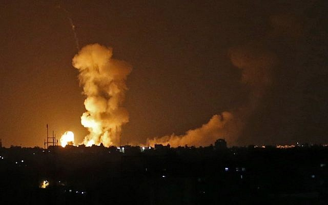 A picture taken on July 20, 2018 shows explosions from Israeli bombardment in Khan Yunis in the southern Gaza Strip. Israeli aircraft and tanks hit targets across the Gaza Strip on July 20 after shots were fired at troops on the border, the army said, with Hamas reporting several members of its military wing killed in the latest flare-up in months of tensions.( AFP PHOTO / SAID KHATIB)
