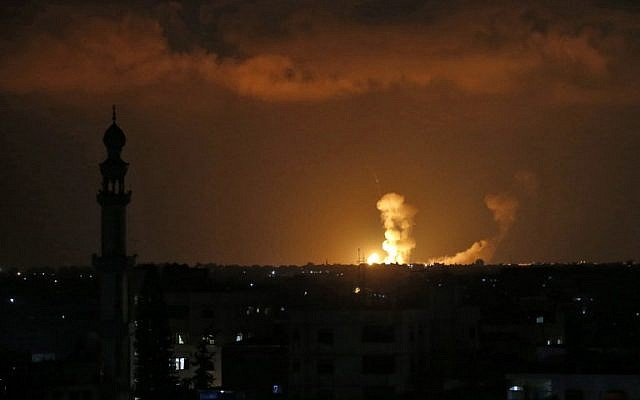 A picture taken on July 20, 2018 shows explosions from Israeli bombardment in Khan Yunis in the southern Gaza Strip. (AFP / SAID KHATIB)