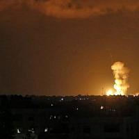 Explosions are seen following Israeli strikes in Khan Younis in the southern Gaza Strip on July 20, 2018. (AFP Photo/Said Khatib)