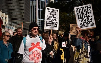 Demonstrators march during a protest to demand humane treatment of asylum seekers and refugees, in Sydney on July 21, 2018. (AFP PHOTO / PETER PARKS)