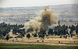 A picture taken on July 22, 2018 from the Israeli-annexed Golan Heights shows a smoke plume rising across the border in Quneitra in southwestern Syria, as rebels destroy their arms stocks prior to their departure. (AFP/ JALAA MAREY)