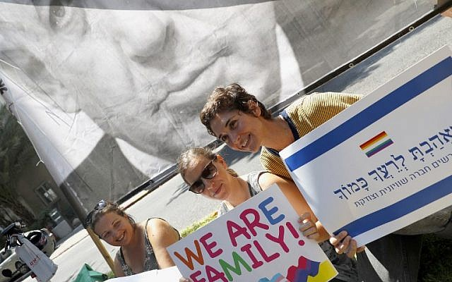Israeli protesters attend a rally in Tel Aviv on July 22, 2018, to protest against a law on surrogacy parenthood that excludes gay men. (AFP/JACK GUEZ)