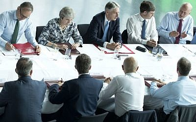 Britain's Prime Minister Theresa May (2L) chairs a meeting of her cabinet at Sage Gateshead, in Gateshead, northeast England, on July 23, 2018. (AFP Photo/Pool/Danny Lawson)