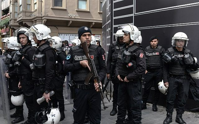 In this photograph taken on April 16, 2018, Turkish security officers stand during a sit-in demonstration called by Turkey's Republican People's Party (CHP) to protest against the extension of the state of emergency at Taksim Square in Istanbul. (AFP/Yasin Akgul)