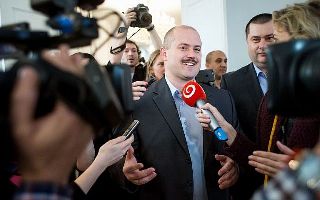 In this file photo taken on March 11, 2016 the leader of the right nationalist LS-Nase Slovensko (Our Slovakia) party Marian Kotleba speaks with journalists before party delegates were intoduced to the parliament in Bratislava. ( AFP PHOTO / VLADIMIR SIMICEK)