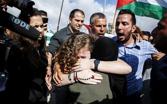 Ahed Tamimi embraces her mother after her release from prison after an eight-month sentence for slapping two Israeli soldiers, in the West Bank village of Nabi Saleh on July 29, 2018. (AFP / ABBAS MOMANI)