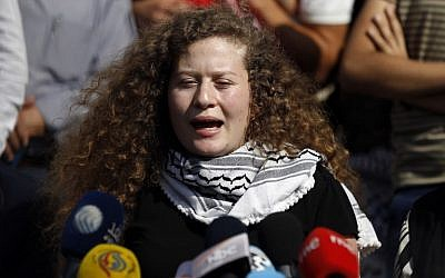 Palestinian teenager Ahed Tamimi speaks at a press conference on the outskirts of the West Bank village of Nabi Saleh on July 29, 2018, after finishing her eight month prison sentence for slapping an Israeli soldier. (AFP Photo/Abbas Momani)