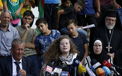 Palestinian activist Ahed Tamimi (C) speaks, as she sits between her father Bassem (C-L) and mother Nariman (C-R), during a press conference in the West Bank village of Nabi Saleh on July 29, 2018 (AFP/ABBAS MOMANI)