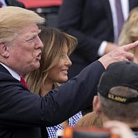 US President Donald Trump and first lady Melania Trump greet guests at a picnic for military families on July 4, 2018 in Washington, DC. (Alex Edelman/Getty Images/AFP)