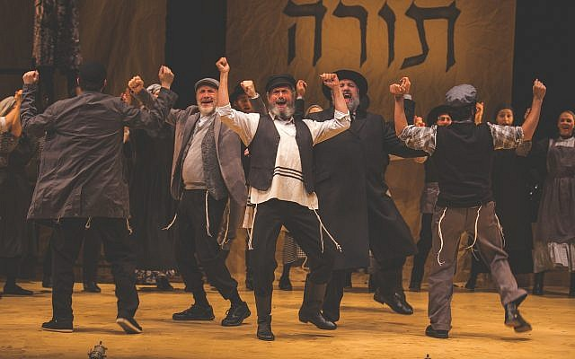 Steven Skybell as Tevye and the ensemble sing 'Tradition' during the National Yiddish Theatre Folksbiene's production of 'Fiddler on the Roof.' (Victor Nechay/ ProperPix.com)