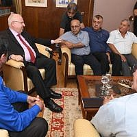 President Reuven Rivlin (L) meeting with Druze community leaders at his residence in Jerusalem on July 29, 2018. (Mark Neiman/ GPO)