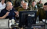 Defense Minister Avigdor Liberman, left, speaks with IDF Chief of Staff Gadi Eisenkot, center, and head of the IDF Southern Command Maj. Gen. Herzl Halevi, right, during an exercise simulating warfare in the Gaza Strip on July 17, 2018. (Ariel Hermoni/Defense Ministry)