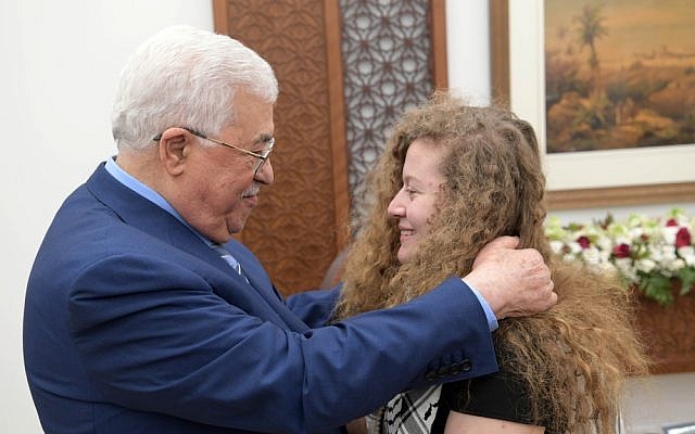 Palestinian Authority President Mahmoud Abbas, meets Ahed Tamimi after her release from Israeli military jail on July 29, 2018. (Thaer Ghanaim)