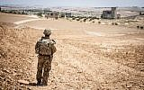 A US soldier provides security during a coordinated, independent patrol along the demarcation line near a village outside Manbij, Syria, June 26, 2018. (US Army photo/Staff Sgt. Timothy R. Koster)