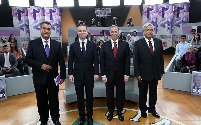 "In this May 20, 2018 file photo released by Mexico's National Electoral Institute, INE, presidential candidates, from left, independent Jaime Rodriguez, known as ""El Bronco,"" Ricardo Anaya of the Forward for Mexico Coalition, Jose Antonio Meade, of the Institutional Revolutionary Party, and Andres Manuel Lopez Obrador, with the MORENA party, attend the second of three debates in Tijuana, Mexico. (INE via AP, File)"