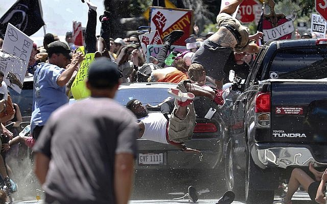 In this August 12, 2017, file photo, people fly into the air as a vehicle is driven into a group of protesters demonstrating against a white nationalist rally in Charlottesville, United States. (Ryan M. Kelly/The Daily Progress via AP, File)