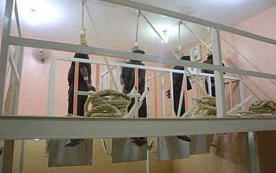 This photo released by Iraq's Ministry of Justice June 29, 2018, shows four men hanging in the gallows in Iraq. (Iraq Ministry of Justice via AP)